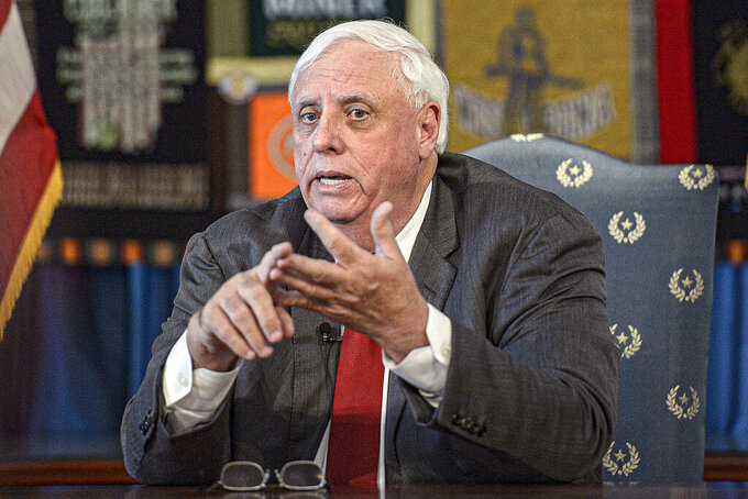 """FILE - In this March 12, 2020, file photo, West Virginia Gov. Jim Justice speaks during a press conference at the State Capitol in Charleston, W.Va. Justice expressed concern Friday about the state's """"alarming"""" number of coronavirus cases as he announced an initiative with schools to get more people vaccinated. (F. Brian Ferguson/Charleston Gazette-Mail via AP, File)"""