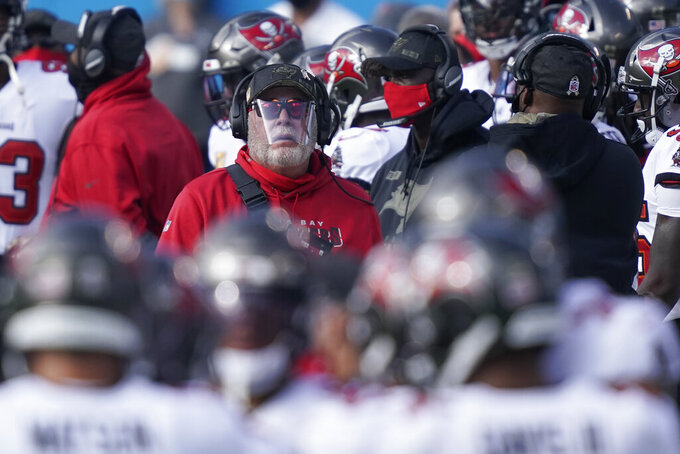 Tampa Bay Buccaneers head coach Bruce Arians walks the sidelines during the first half of an NFL football game against the Carolina Panthers, Sunday, Nov. 15, 2020, in Charlotte , N.C. (AP Photo/Gerry Broome)