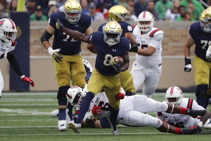 FILE - In this Sept. 8, 2018, file photo, Notre Dame wide receiver/running back Jafar Armstrong (8) runs with the ball against Ball State during the first half of an NCAA college football game in South Bend, Ind. There is no Dexter Williams in the backfield this season for No. 9 Notre Dame. Instead, the Fighting Irish will look to a stable of running backs to pick up the slack, including Tony Jones and converted wide receiver Jafar Armstrong. (AP Photo/Nam Y. Huh, File)