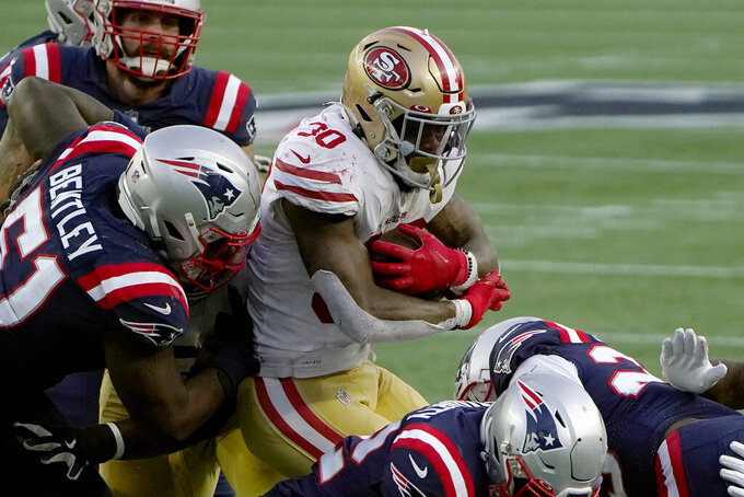 New England Patriots linebacker Ja'Whaun Bentley (51) tackles San Francisco 49ers running back Jeff Wilson Jr. (30) in the first half of an NFL football game, Sunday, Oct. 25, 2020, in Foxborough, Mass. (AP Photo/Steven Senne)