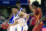 Kansas guard Devon Dotson (1) steals the ball from Iowa State guard Prentiss Nixon (11) during the first half of an NCAA college basketball game in Lawrence, Kan., Monday, Feb. 17, 2020. (AP Photo/Orlin Wagner)