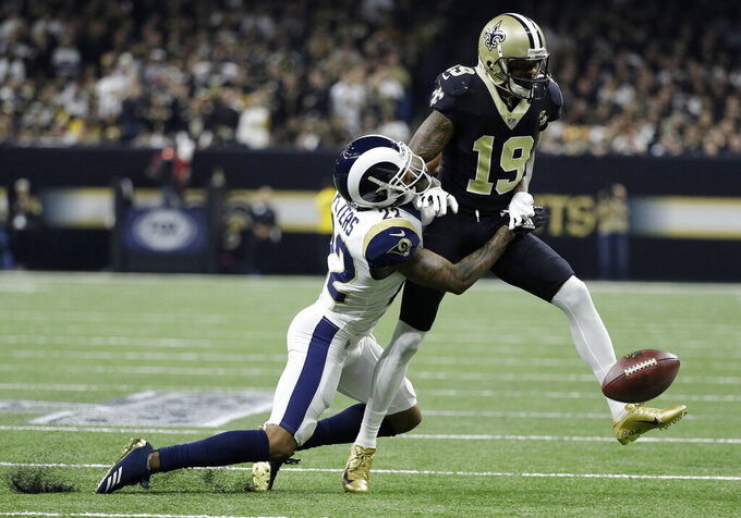 Los Angeles Rams' Marcus Peters breaks up a pass intended for New Orleans Saints' Ted Ginn during the first half of the NFL football NFC championship game, Sunday, Jan. 20, 2019, in New Orleans. (AP Photo/David J. Phillip)