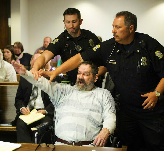 FILE - In this Nov. 10, 2015, file photo, Frazier Glenn Miller Jr., convicted of capital murder, attempted murder and other charges, gestures as Johnson County deputies remove Miller from the courtroom during the sentencing phase of his trial at the Johnson County District Court in Olathe, Kan. Miller, who fatally shot three people at Jewish sites in Kansas has died in prison, Monday, May 3, 2021, at the El Dorado Correctional Facility. (Joe Ledford/The Kansas City Star via AP, Pool, File)