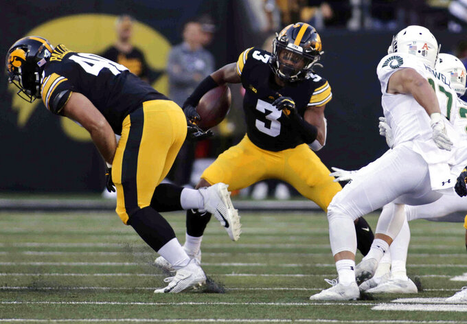 Iowa wide receiver Tyrone Tracy Jr. (3) runs with the ball in the second half of an NCAA college football game against Colorado State, Saturday, Sept. 25, 2021, in Iowa City, Iowa. (AP Photo/Ron Johnson)
