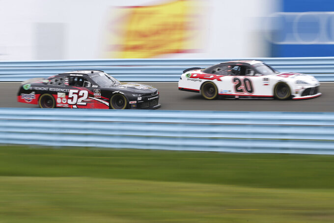 Harrison Burton (20) and David Smith (520 race through the esses during a NASCAR Xfinity Series auto race at Watkins Glen International in Watkins Glen, N.Y., on Saturday, Aug. 7, 2021. (AP Photo/Joshua Bessex)