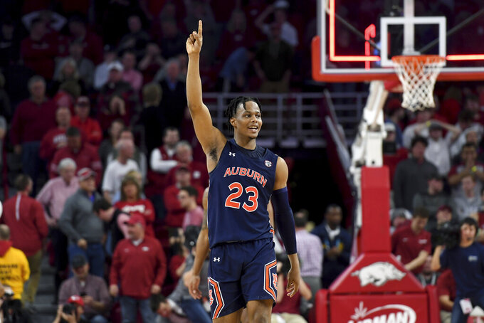 Auburn's Isaac Okoro (23) celebrates after Auburn defeated Arkansas 79-76 in overtime in an NCAA college basketball game Tuesday, Feb. 4, 2020, in Fayetteville, Ark. (AP Photo/Michael Woods)