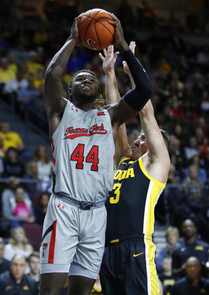 Texas Tech's Chris Clarke (44) shoots over Iowa's Jordan Bohannon (3) during the first half of an NCAA college basketball game Thursday, Nov. 28, 2019, in Las Vegas. (AP Photo/John Locher)