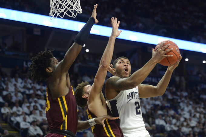 Penn State's Myles Dread (2) goes to the basket against Minnesota's Daniel Oturu, left,and Gabe Kalscheur (22) during first-half action of an NCAA college basketball game, Saturday, Feb. 8, 2020, in State College, Pa. (AP Photo/Gary M. Baranec)