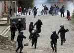 Supporters of former President Evo Morales clash with police in La Paz, Bolivia, Nov. 11, 2019. (AP Photo/Juan Karita)