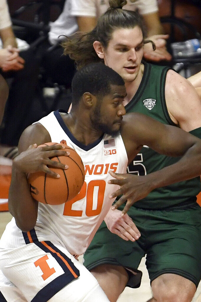 Illinois guard Da'Monte Williams (20) drives past Ohio forward Ben Vander Plas (5) in the first half of an NCAA college basketball game Friday, Nov. 27, 2020, in Champaign, Ill. (AP Photo/Holly Hart)