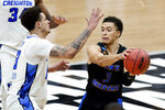 UC Santa Barbara's JaQuori McLaughlin (3) is defended by Creighton's Christian Bishop (13) during the first half of a college basketball game in the first round of the NCAA tournament at Lucas Oil Stadium in Indianapolis Saturday, March 20, 2021. (AP Photo/Mark Humphrey)