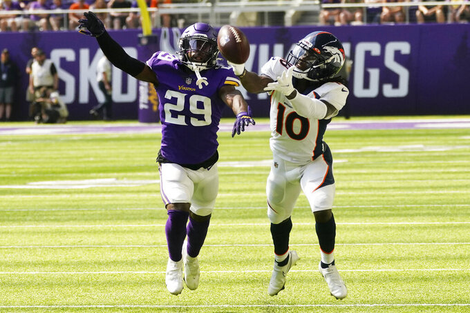 Minnesota Vikings defensive back Kris Boyd (29) breaks up a pass intended for Denver Broncos wide receiver Jerry Jeudy (10) during the first half of an NFL preseason football game, Saturday, Aug. 14, 2021, in Minneapolis. (AP Photo/Jim Mone)