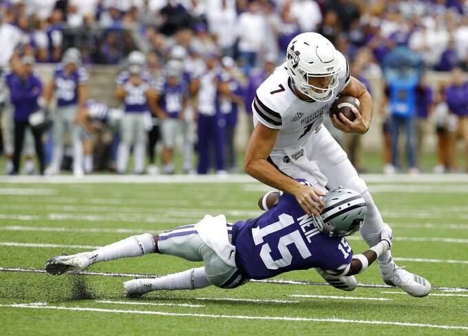 Mississippi State quarterback Nick Fitzgerald (7) is tackled by Kansas State defensive back Walter Neil Jr. (15) during the first half of an NCAA college football game Saturday, Sept. 8, 2018, in Manhattan, Kan. (AP Photo/Charlie Riedel)
