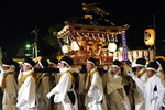 In this Tuesday, Dec. 3, 2019, photo,  white-clad men carry a mikoshi, a portable shrine, during the Chichibu Night Festival in Chichibu, north of Tokyo, Japan. Shinto is Japan's indigenous religion that goes back centuries. It is an animism that believes there are thousands of kami, or spirits, inhabiting nature, such as forests, rivers and mountains. (AP Photo/Toru Hanai)