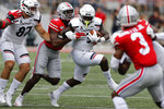 Cincinnati running back Michael Warren, center, tries to cut upfield past Ohio State linebacker Baron Browning during the first half of an NCAA college football game Saturday, Sept. 7, 2019, in Columbus, Ohio. (AP Photo/Jay LaPrete)