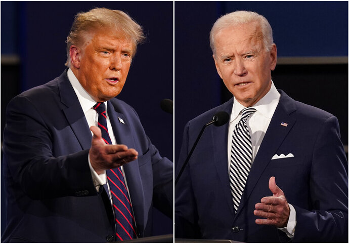 FILE - This combination of Sept. 29, 2020, file photos shows President Donald Trump, left, and former Vice President Joe Biden during the first presidential debate at Case Western University and Cleveland Clinic, in Cleveland, Ohio. Trump and Biden have starkly different visions for the international role of the United States — and the presidency.  (AP Photo/Patrick Semansky, File)