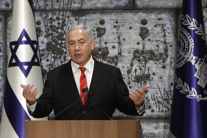 FILE - In this Wednesday, Sept. 25, 2109 file photo, Israeli Prime Minister Benjamin Netanyahu gives a statement in Jerusalem. For the sixth time in his lengthy political career, Netanyahu has been tasked by Israel's president to form a new government. This time it's no mere formality, but rather a daunting endeavor that looks like mission impossible. (AP Photo/Sebastian Scheiner, File)