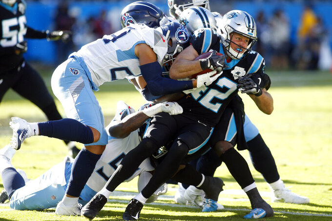 Tennessee Titans defensive back Dane Cruikshank (29) hits Carolina Panthers strong safety Colin Jones (42) during the second half of an NFL football game in Charlotte, N.C., Sunday, Nov. 3, 2019. (AP Photo/Brian Blanco)