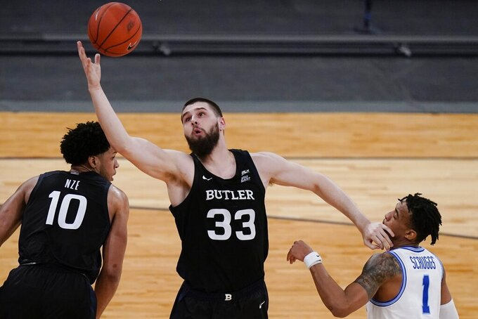 Butler's Bryce Golden (33) fights for a rebound with Xavier's Paul Scruggs (1) during the second half of an NCAA college basketball game in the Big East conference tournament Wednesday, March 10, 2021, in New York. (AP Photo/Frank Franklin II)