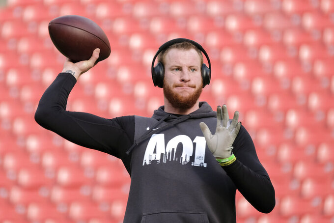 Philadelphia Eagles quarterback Carson Wentz warming up before the start of an NFL football game against the Washington Redskins, Sunday, Dec. 15, 2019, in Landover, Md. (AP Photo/Mark Tenally)