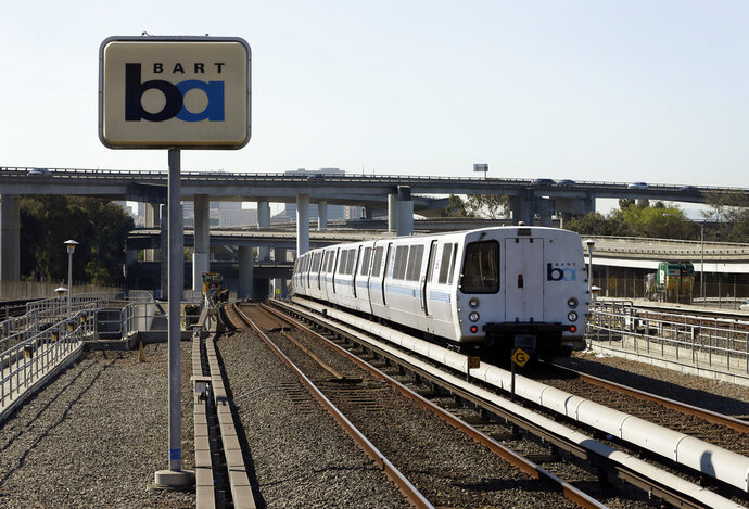 FILE - In this Oct. 15, 2013 file photo, a Bay Area Rapid Transit train leaves the station in Oakland, Calif. Regulators fined a Northern California transit agency $650,000 for safety failures that led to a train fatally striking two workers inspecting track five years ago during a union strike. (AP Photo/Ben Margot, File)