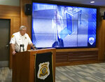 Salt Lake City assistant Police Chief Tim Doubt releases video footage of a missing University of Utah student walking at Salt Lake City International Airport, during a news conference Tuesday, June 25, 2019, in Salt Lake City. Mackenzie Lueck, 23, was last seen June 17, when she took a Lyft car from the airport to a park located miles from her apartment. Police say she didn't seem distressed when she met with someone at about 3 a.m. (AP Photo/Rick Bowmer)