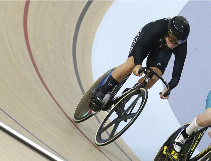 FILE - In this file photo dated Friday, April 6, 2018, New Zealand's Olivia Podmore competes during the Women's Sprint quarterfinals at the Anna Meares Velodrome during the 2018 Commonwealth Games in Brisbane, Australia.  The New Zealand Olympic Committee says track cyclist Olivia Podmore has died suddenly at the age of 24, in a statement released Tuesday Aug. 10, 2021, without disclosing the cause of death. (AP Photo/Tertius Pickard, FILE)