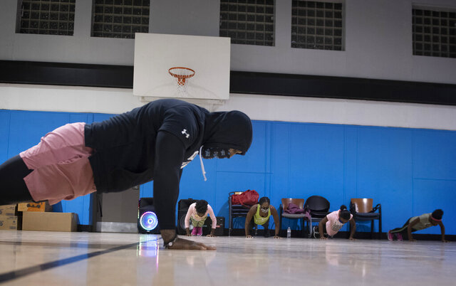 Chris Edmonds, a Woodland High School graduate and former NFL player, teaches fitness classes to a chronically underserved population in Braddock, Pa., Thursday, Dec. 10, 2020. (Steve Mellon/Pittsburgh Post-Gazette via AP)