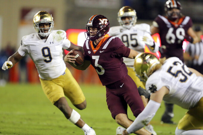 Virginia Tech quarterback Braxton Burmeister (3) runs for a touchdown during the second half of an NCAA college football game against Notre Dame in Blacksburg, Va., Saturday, Oct. 9, 2021. (AP Photo/Matt Gentry)