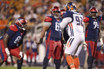 FILE - In this Feb. 23, 2019, file photo, Memphis Express center Demetrius Rhaney (65) signals teammates before a snap against the Orlando Apollos during an AAF football game in Orlando, Fla. The American Alliance of Football halted operations just two months into its first and only season. Some Memphis Express players were purportedly stuck with hefty hotel bills when the AAF was suspended. Center Demetrius Rhaney, who signed with the Buffalo Bills earlier this month after spending time with the Express, wound up with an invoice for an MRI exam he had on his hand. (AP Photo/Rick Wilson, File)