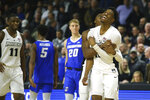 Providence's A.J. Reeves, front, celebrates a three-pointer with David Duke, behind, during the second half of an NCAA college basketball game against Creighton Wednesday, Feb. 5, 2020, in Providence, R.I. (AP Photo/Stew Milne)