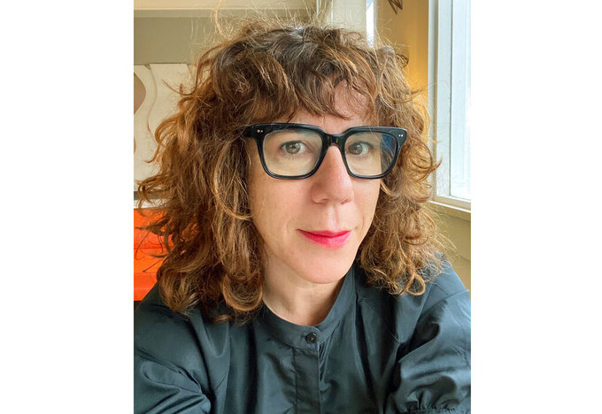 This image released by Ecco/HarperCollins shows author Jami Attenberg, founder of the 1,000 word challenge, calling for people to write 1,000 words a day for 14 days. The 2021 challenge began May 31 and ends Sunday. (Jami Attenberg via AP)