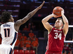 Wisconsin guard Brad Davison (34) shoots over Illinois guard Ayo Dosunmu (11) during the second half of an NCAA college basketball game in Champaign, Ill., Wednesday, Jan. 23, 2019. (AP Photo/Stephen Haas)