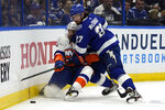 Tampa Bay Lightning defenseman Ryan McDonagh (27) drives New York Islanders center Mathew Barzal (13) into the dasher during the third period in Game 1 of an NHL hockey Stanley Cup semifinal playoff series Sunday, June 13, 2021, in Tampa, Fla. (AP Photo/Chris O'Meara)