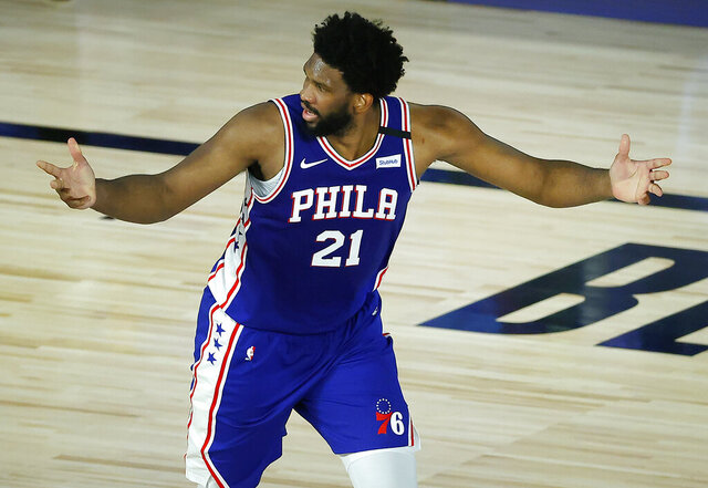 Philadelphia 76ers' Joel Embiid reacts after a basket during the third quarter of an NBA basketball game against the Orlando Magic, Friday, Aug. 7, 2020, in Lake Buena Vista, Fla. (Kevin C. Cox/Pool Photo via AP)