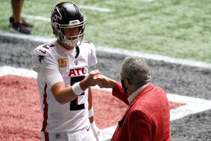 Atlanta Falcons quarterback Matt Ryan fist bumps with Atlanta Falcons Owner Arthur Blank before the first half of an NFL football game against the Denver Broncos, Sunday, Nov. 8, 2020, in Atlanta. (AP Photo/Brynn Anderson)