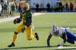 Baylor running back JaMycal Hasty (6) gets past Kansas linebacker Azur Kamara (5) as he runs for a touchdown during the first half of an NCAA college football game Saturday, Nov. 30, 2019, in Lawrence, Kan. (AP Photo/Charlie Riedel)