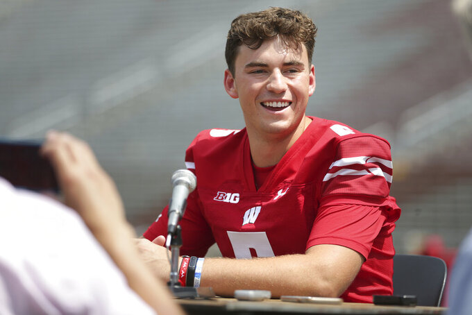 FILE - Wisconsin quarterback Graham Mertz is interviewed during the team's NCAA college football media day at Camp Randall Stadium in Madison, Wis., in this Thursday, Aug. 5, 2021, file photo. Mertz and the Wisconsin Badgers are eager to show how far they've come since a disappointing 2020 season that ended with a 4-3 record. They'll get a chance to showcase that Saturday with a tough season-opening test against No. 19 Penn State. (Kayla Wolf/Wisconsin State Journal via AP, File)