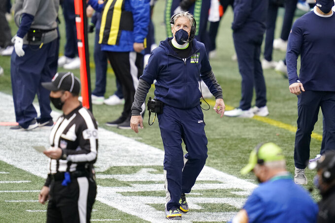 Seattle Seahawks head coach Pete Carroll looks toward the scoreboard during the first half of an NFL football game against the New York Giants, Sunday, Dec. 6, 2020, in Seattle. (AP Photo/Elaine Thompson)