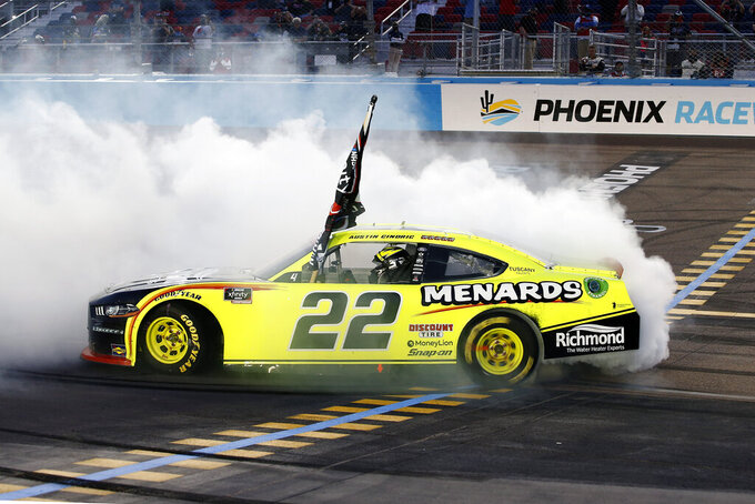 Austin Cindric does a burnout at the finish line after winning the season championship and a NASCAR Xfinity Series auto race at Phoenix Raceway, Saturday, Nov. 7, 2020, in Avondale, Ariz. (AP Photo/Ralph Freso)