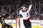 Colorado Avalanche's Andre Burakovsky, right, of Austria, celebrates his goal against Vancouver Canucks goalie Thatcher Demko during the third period of an NHL hockey game Saturday, Nov. 16, 2019, in Vancouver, British Columbia. (Darryl Dyck/The Canadian Press via AP)