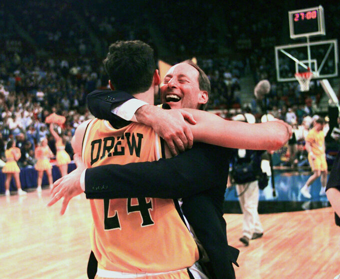 FILE - In this March 13, 1998, file photo, Valparaiso's head coach Homer Drew hugs his son, Bryce Drew, after Bryce hit a game-winning three-point shot at the buzzer to beat Mississippi 70-69 in the first round of the NCAA Midwest Regional college basketball game in Oklahoma City. (AP Photo/John Gaps III, File)