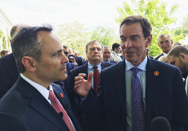 FILE - In a Wednesday, April 26, 2017 file photo, Braidy Industries Inc. CEO Craig Bouchard, right, and Republican Gov. Matt Bevin speak with reporters in Wurtland, Ky. Bouchard claims the defendants breached their obligations under a company voting agreement after refusing his efforts to remove four executives from Braidy's board. Bouchard was removed as CEO in a management shakeup in January 2020. He filed suit on Friday, Feb. 14, in Delaware. (AP Photo/Adam Beam, File)