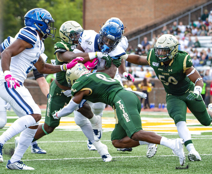 The William & Mary defense swarms Villanova running back Justin Covington during an NCAA college football game Saturday, Oct. 5, 2019 in Williamsburg, Va. (Mike Caudill/The Virginian-Pilot via AP)