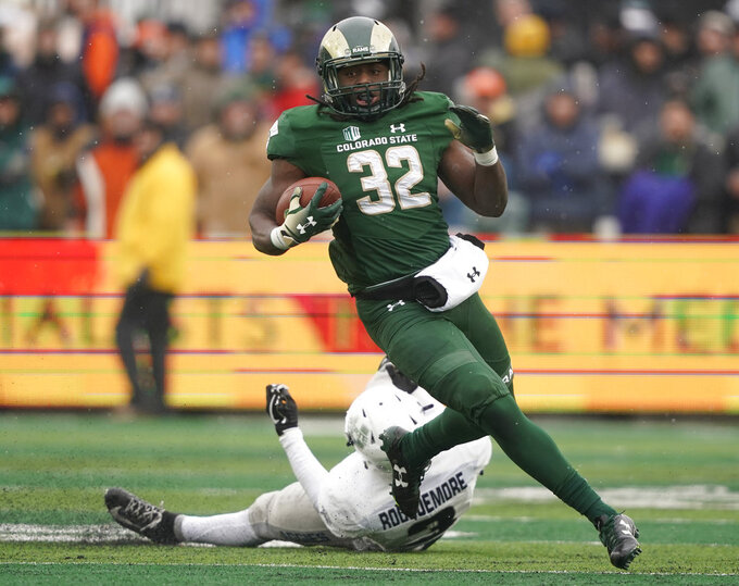 Colorado State running back Marcus McElroy (32) runs against Utah State safety Jontrell Rocquemore (3) during the first half of an NCAA football game Saturday, Nov. 17, 2018, in Fort Collins, Colo. (AP Photo/Jack Dempsey)