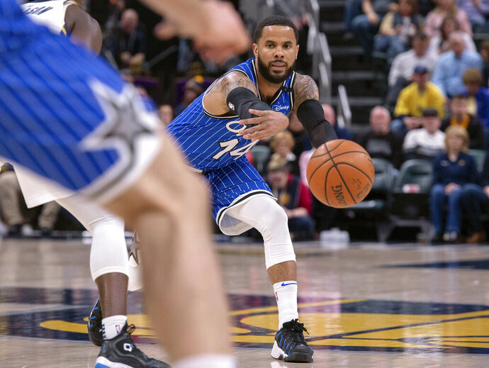 Orlando Magic guard D.J. Augustin (14) makes a pass inside to a teammate during the first half of an NBA basketball game against the Indiana Pacers, Saturday, March 30, 2019, in Indianapolis. (AP Photo/Doug McSchooler)