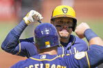 Milwaukee Brewers' Avisail Garcia, right, is congratulated by teammate Daniel Vogelbach after hitting a two-run home run during the first inning of a baseball game against the St. Louis Cardinals Sunday, April 11, 2021, in St. Louis. (AP Photo/Jeff Roberson)