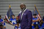 Former Dallas Cowboy and Football Hall of Famer Emmitt Smith speaks at Emmett J. Conrad High School in Dallas, Tuesday, June 29, 2021. (AP Photo/Carolyn Kaster, Pool)