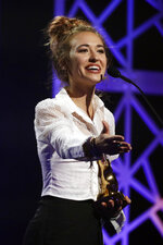 Lauren Daigle accepts the artist of the year award during the Dove Awards on Tuesday, Oct. 15, 2019, in Nashville, Tenn. (AP Photo/Mark Humphrey)