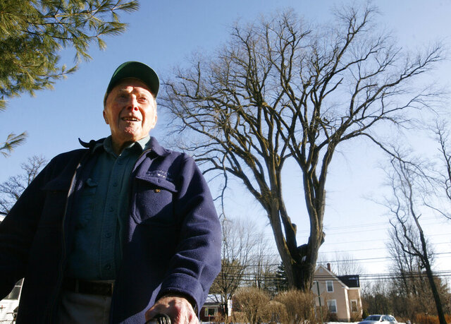 FILE - In this Dec. 14, 2009 file photo, Frank Knight, 101, of Yarmouth, Maine, stands in front of an elm tree known as